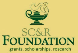 SCR Foundation logo on gold